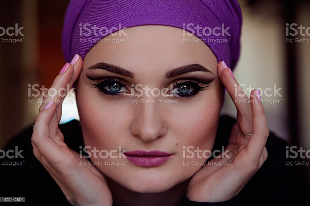 Amazing girl with beautiful eyes in purple scarf royalty-free stock photo