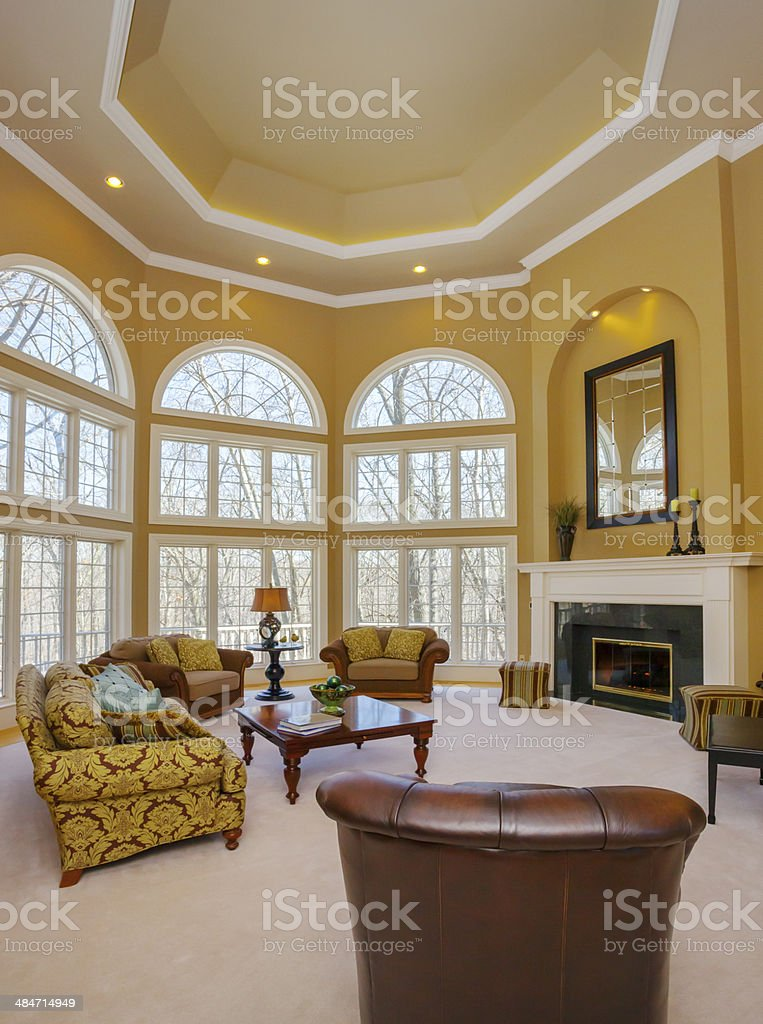 Amazing Great Room With Vaulted Ceiling and Two Story Windows stock photo