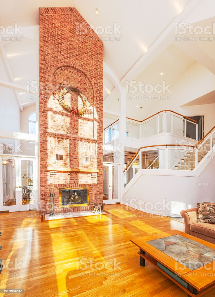 Amazing home interior architecture, cathedral ceiling with brick fireplace stock photo