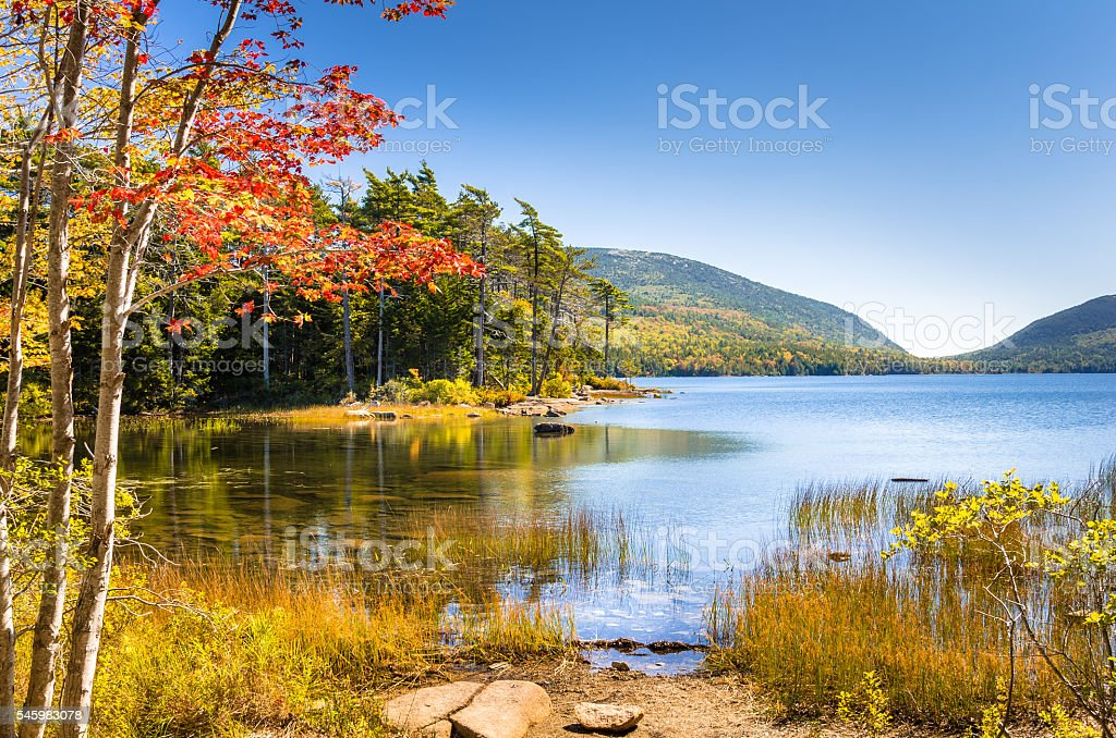 Amazing Lake in Autumn Colours and Blue Sky stock photo