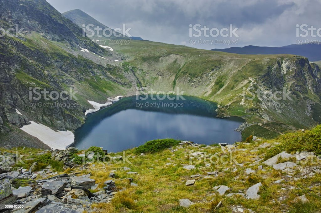 Amazing landscape of The Eye lake, The Seven Rila Lakes stock photo