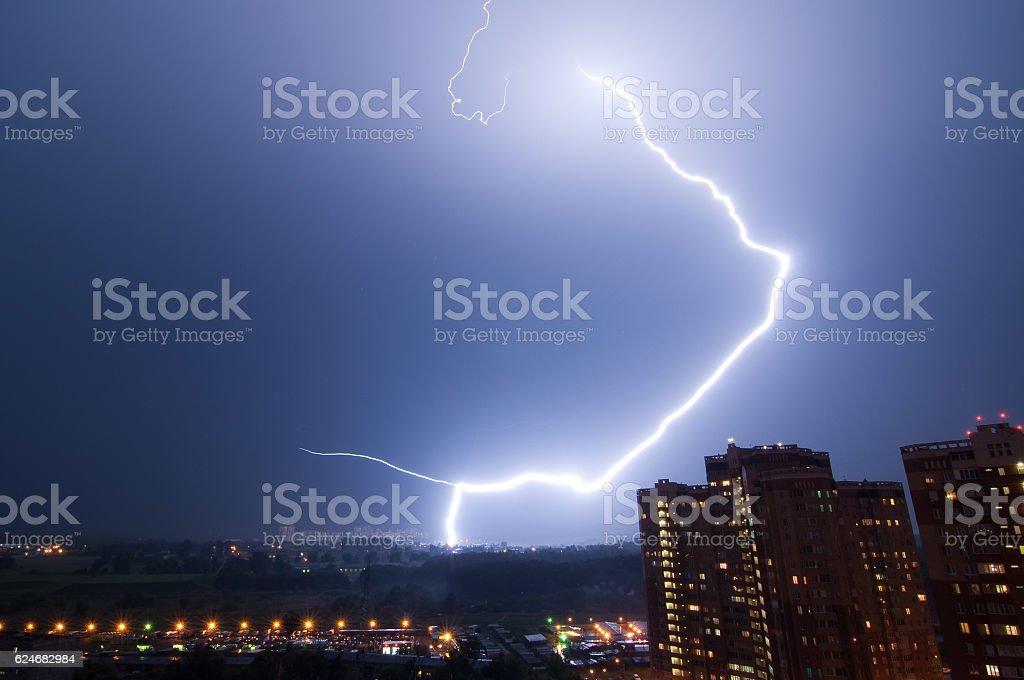 Amazing lightning strike over city. stock photo