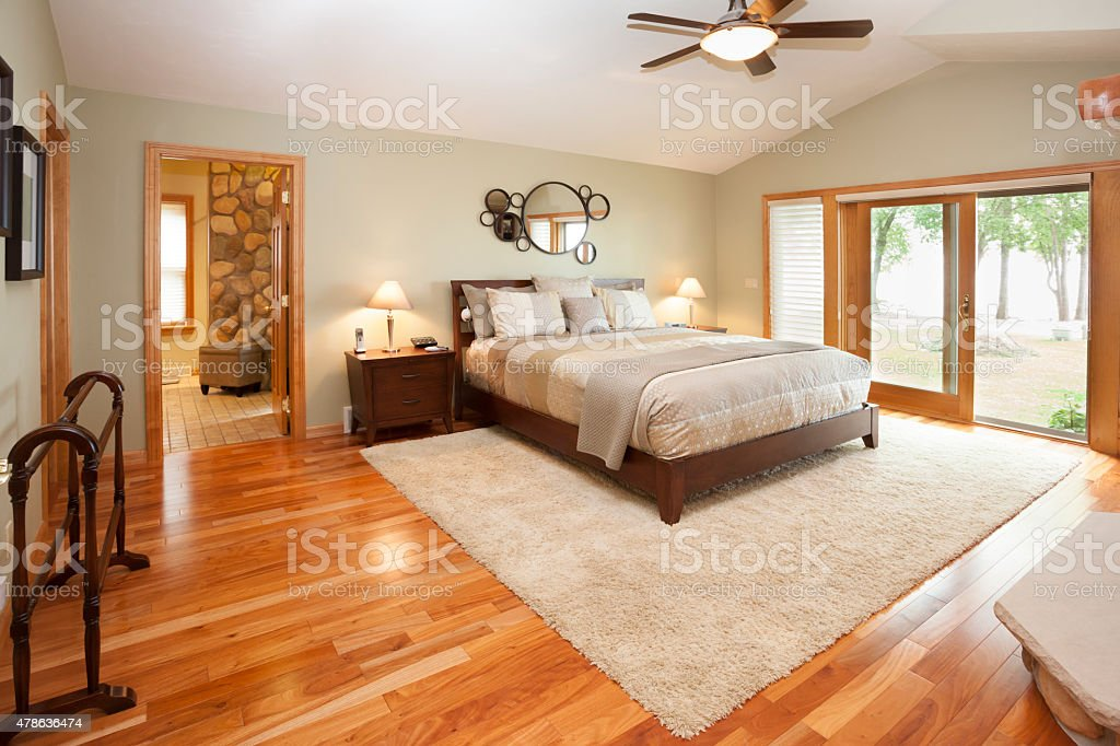 Amazing Master Bedroom  Suite with Hardwood Floor, Raised Ceiling stock photo