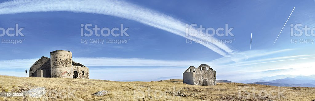Amazing mountain top panorama with plain trails over sky royalty-free stock photo