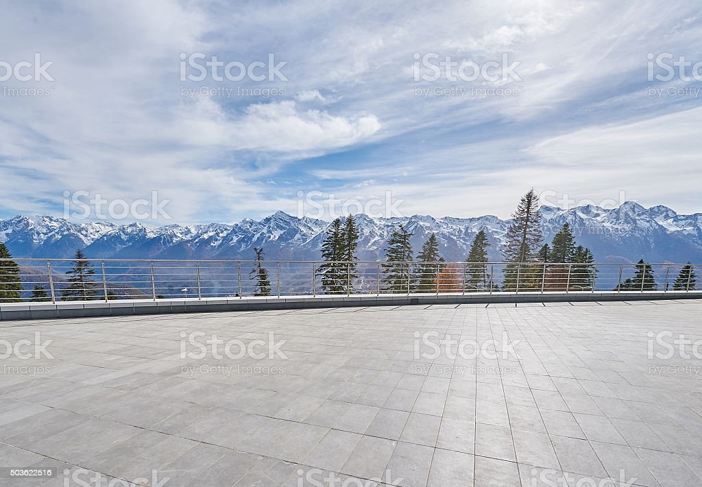 amazing mountains view from hotel terrace on sunny winter day stock photo
