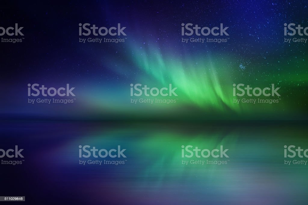 Amazing northern lights reflection over reflection on the sea stock photo