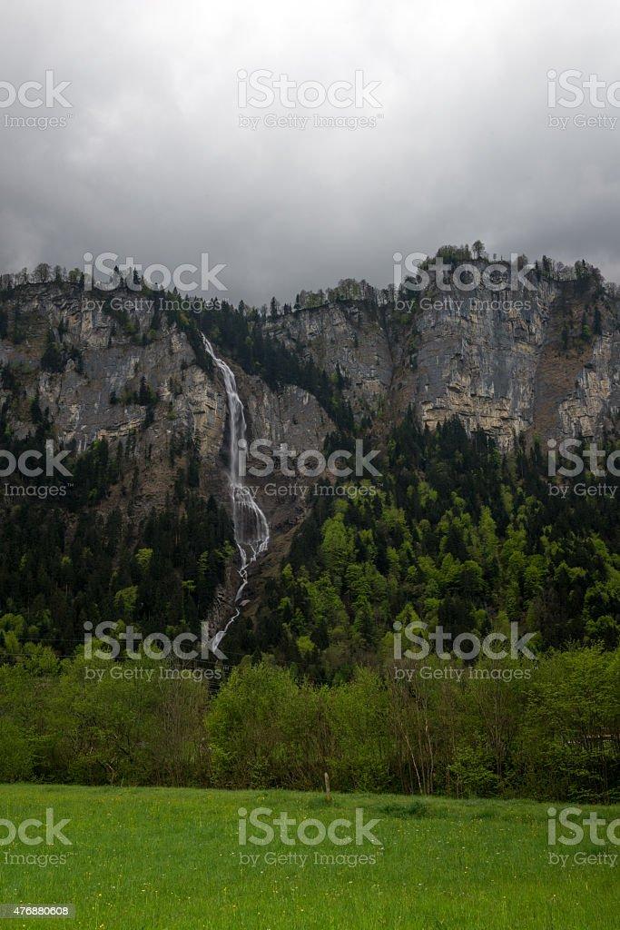 Amazing Oltschibachfall waterfall (140 m) in Swiss Alps, Meiringen, Switzerland stock photo