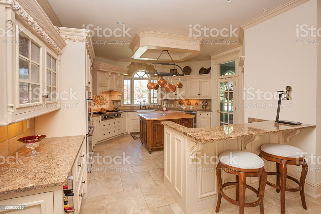 Amazing ornate kitchen with marble counter tops. stock photo