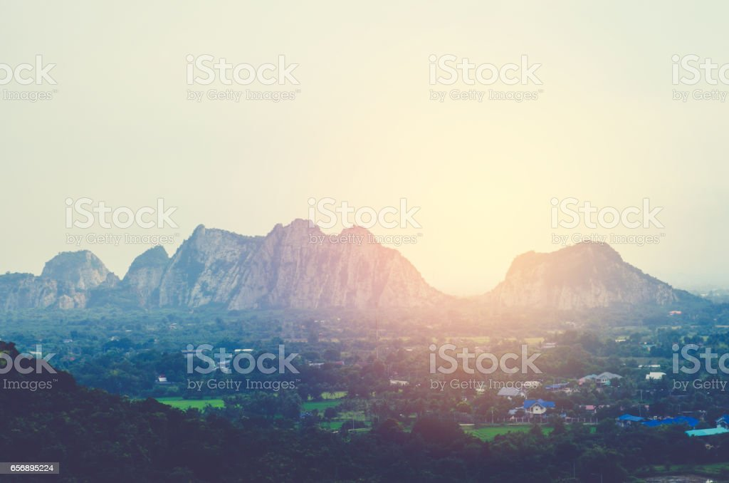 Amazing picture of green mountain landscape with blue sky and white clouds. Great nature scenery of green mountain range under sunlight at the middle of summer day stock photo