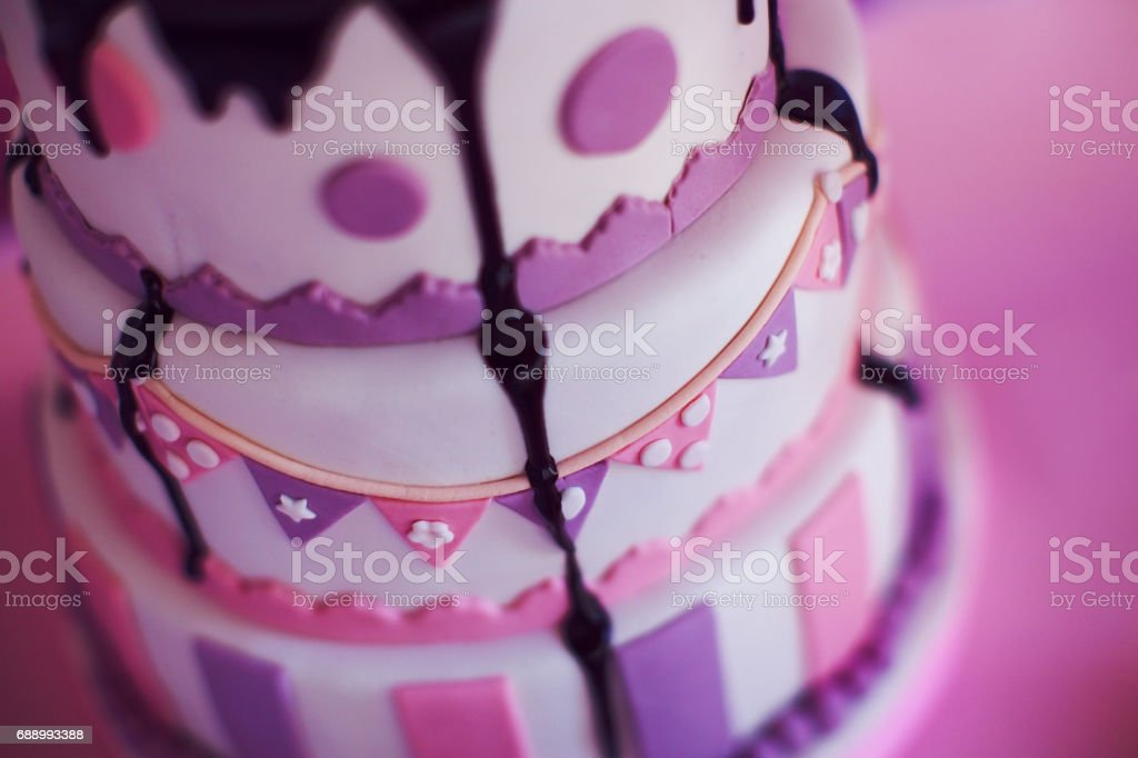Amazing ping cake for girl's birthday closeup stock photo