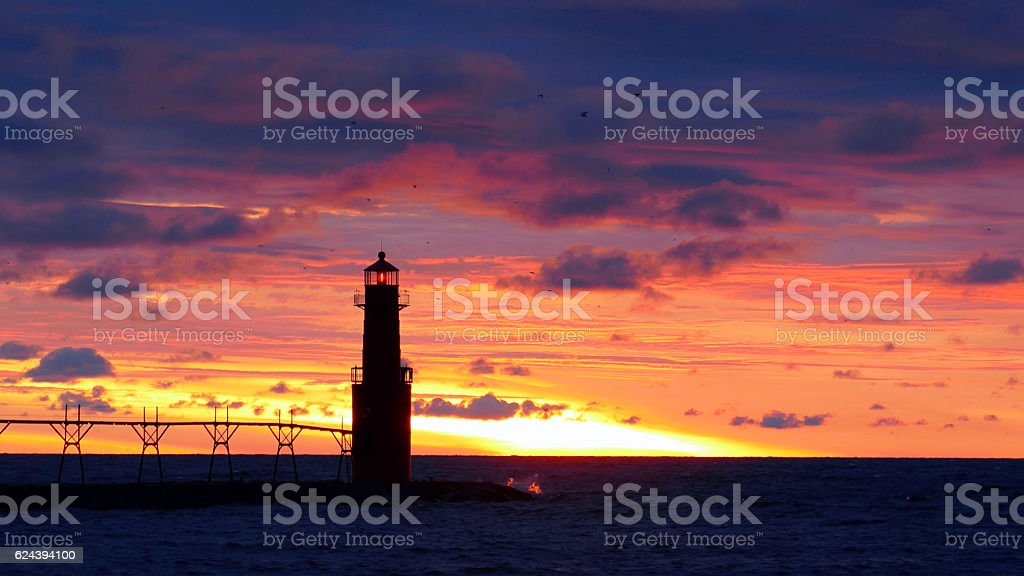 Amazing predawn red sky with Lake Michigan lighthouse stock photo