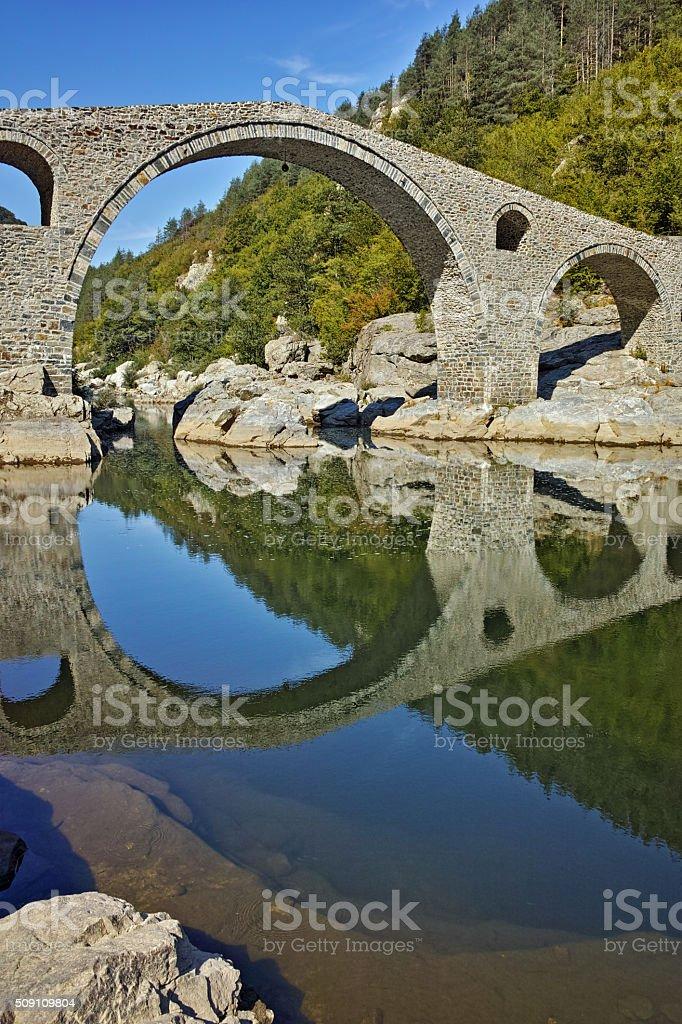 Amazing Reflection of Devil's Bridge in Arda river, Bulgaria stock photo