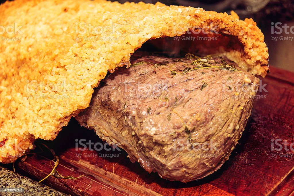 Amazing roast beef with herbs wooden board. stock photo