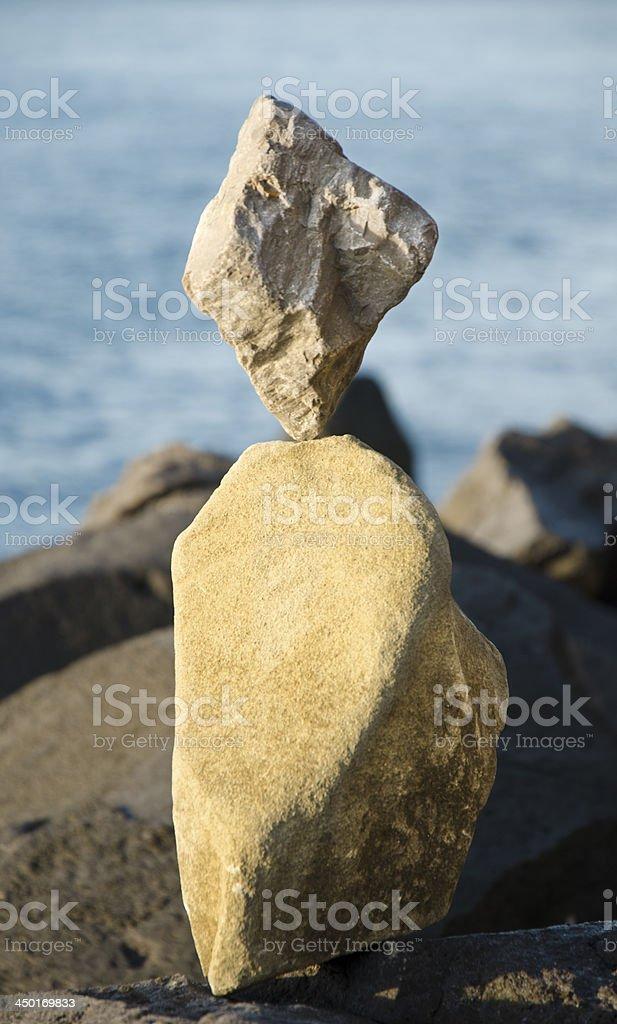 Amazing rock balancing on the sea stock photo