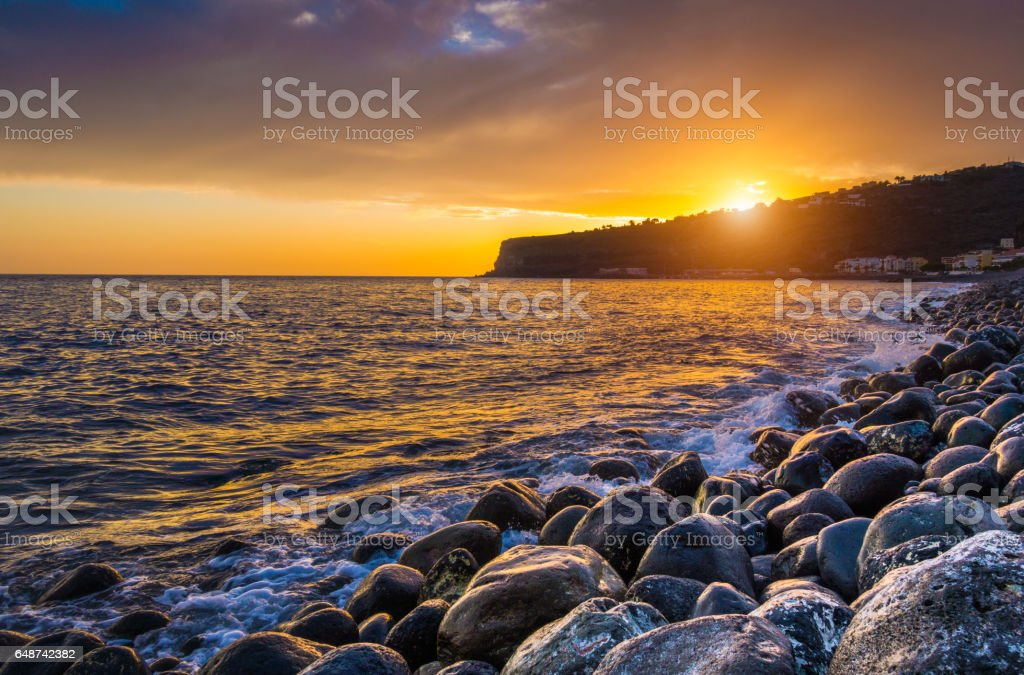 Amazing seascape in golden evening light at sunset stock photo