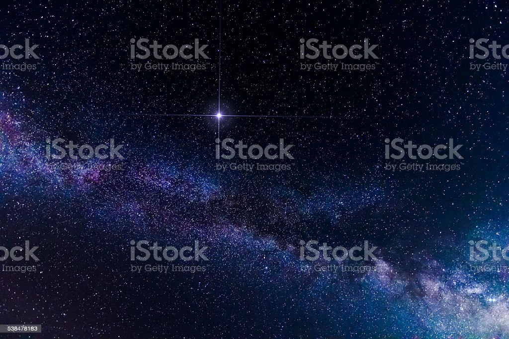 Amazing spike glowing lucky star and Milky Way Galaxy background stock photo