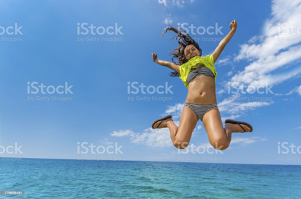 Amazing summer teen jump above ocean blue water horizon. stock photo