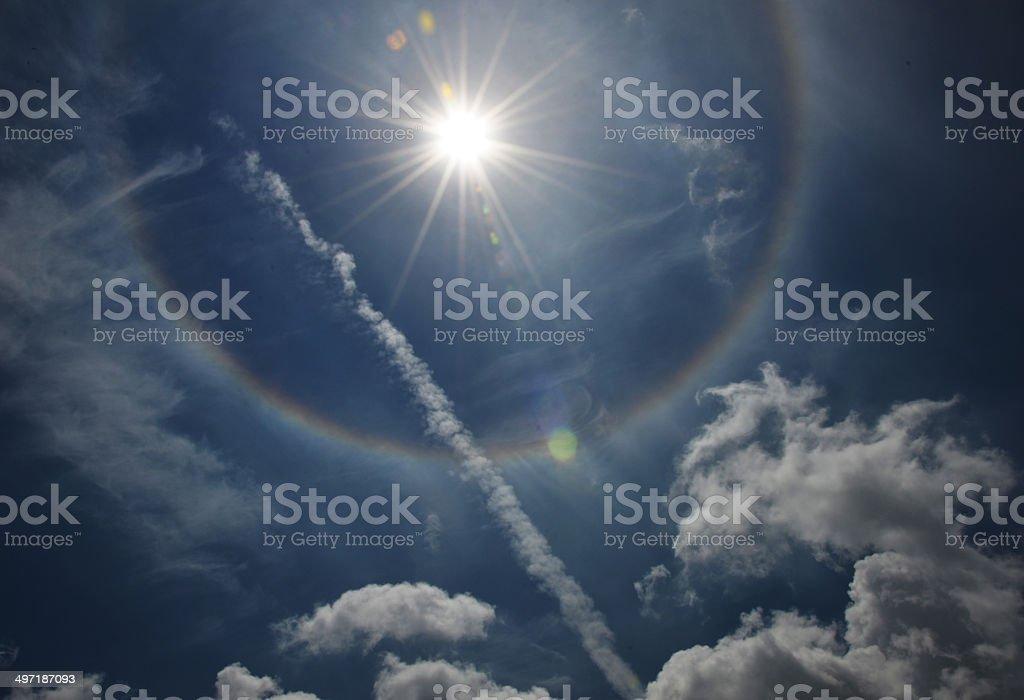 Amazing sun halo and smoke of fighter stock photo