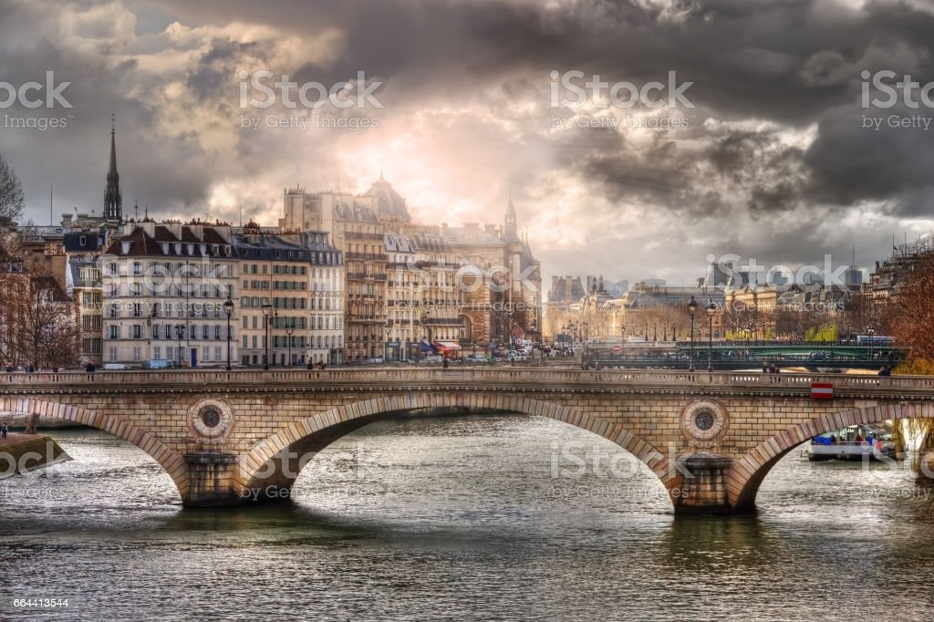 Amazing sunlight above of the Pont Louis-Philippe stock photo