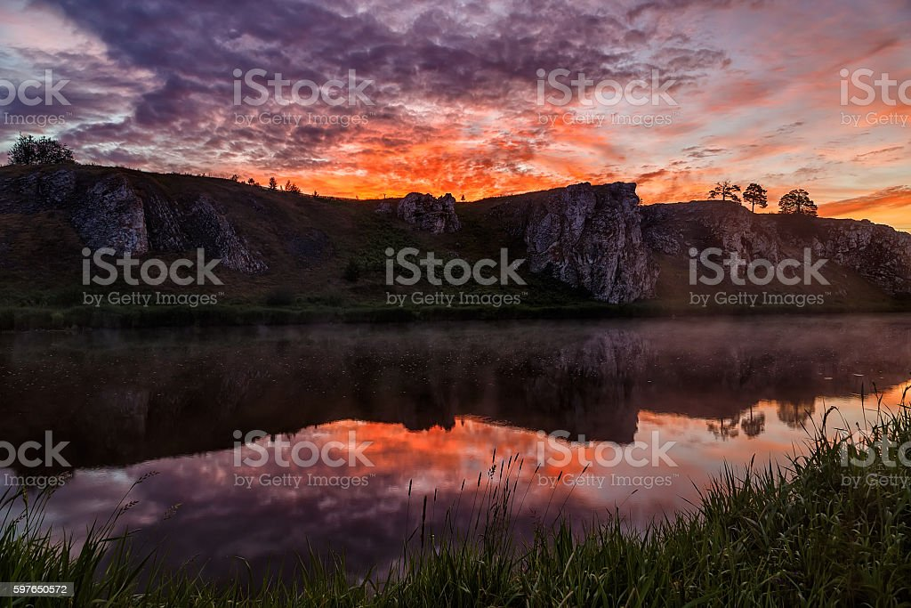 amazing sunrise over the river with fog Russian Urals stock photo