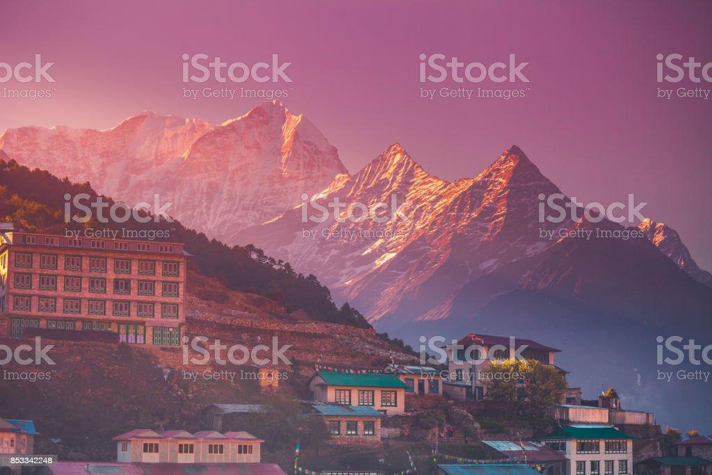 Amazing sunrise view of Namche Bazaar village stock photo