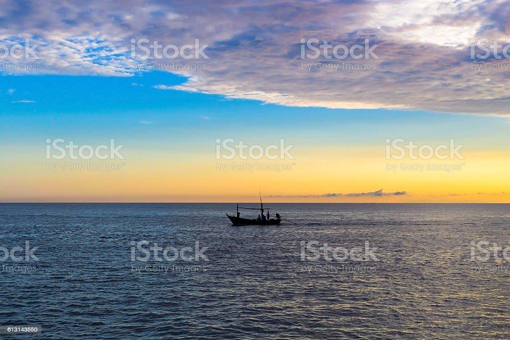 Amazing sunrise with silhouette image fishing boat stock photo
