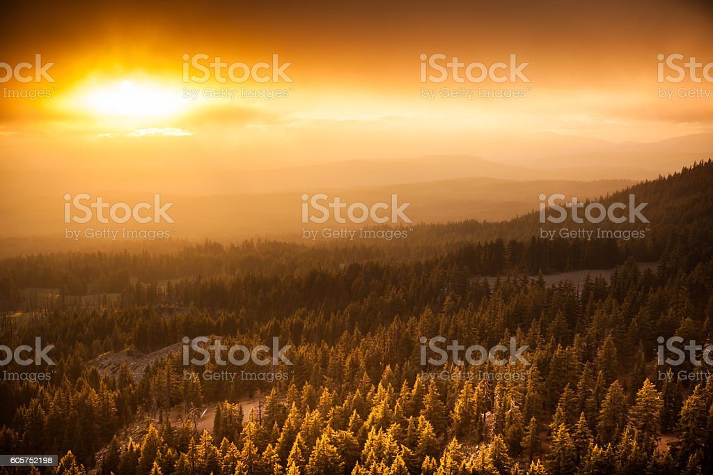 Amazing sunset looking west from Crater Lake National Park. stock photo