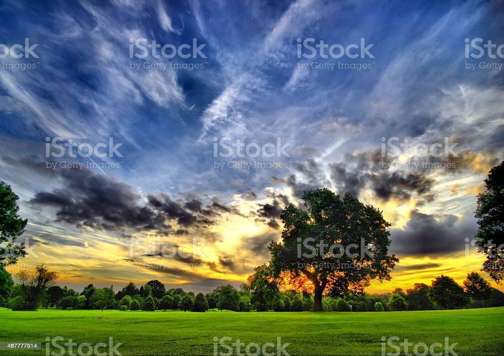 amazing sunset on a golf course stock photo
