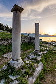 Amazing sunset with columns on Evraiokastro Archaeological Site, Thassos town
