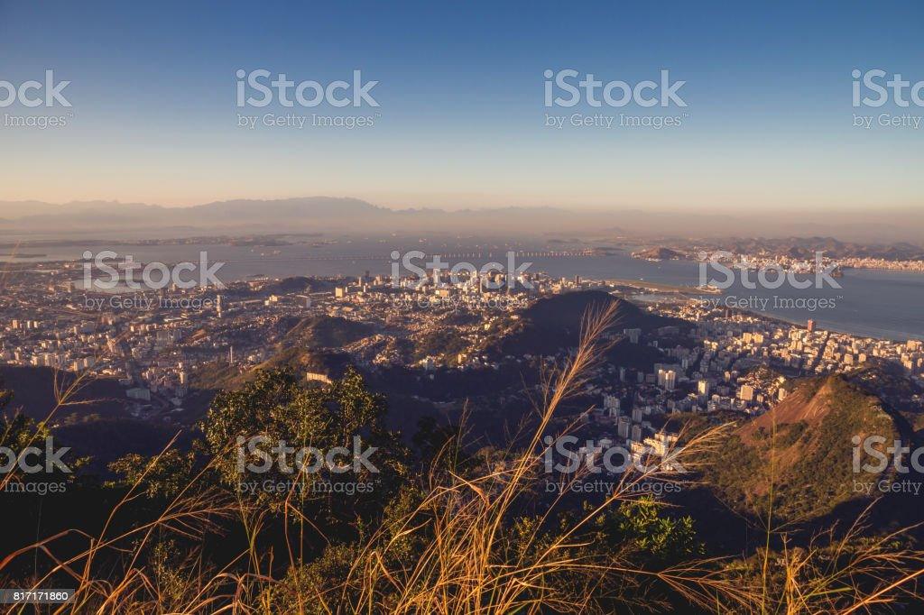 Amazing view from the Corcovado mountain on the Guanabara bay with, Atlantic ocean, Botafogo and Flamengo district, sunset, evening. stock photo