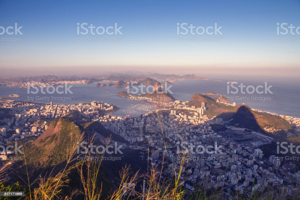 Amazing view from the Corcovado mountain on the Guanabara bay with Sugarloaf mountain, Atlantic ocean, Botafogo and Flamengo district, sunset, evening. stock photo