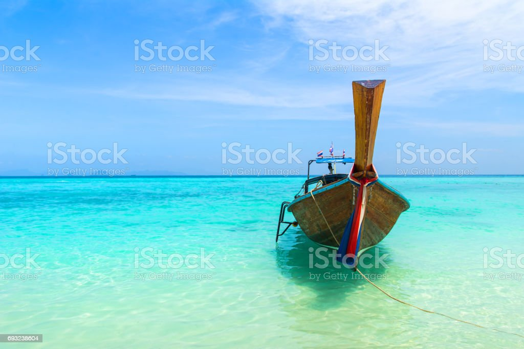 Amazing view of beautiful beach with traditional thailand longtale boat. Location: Bamboo island, Krabi province, Thailand, Andaman Sea. Artistic picture. Beauty world. stock photo