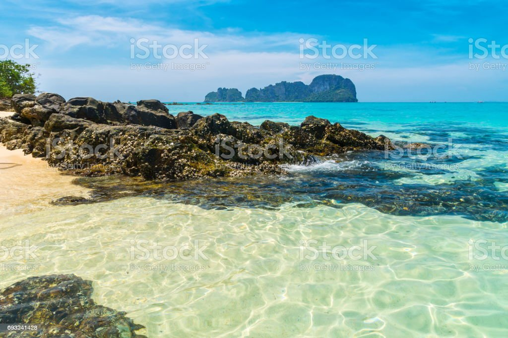Amazing view of beautiful island with transparent turquoise water in the foreground. Location: Bamboo island, Krabi province, Thailand, Andaman Sea. Artistic picture. Beauty world. stock photo