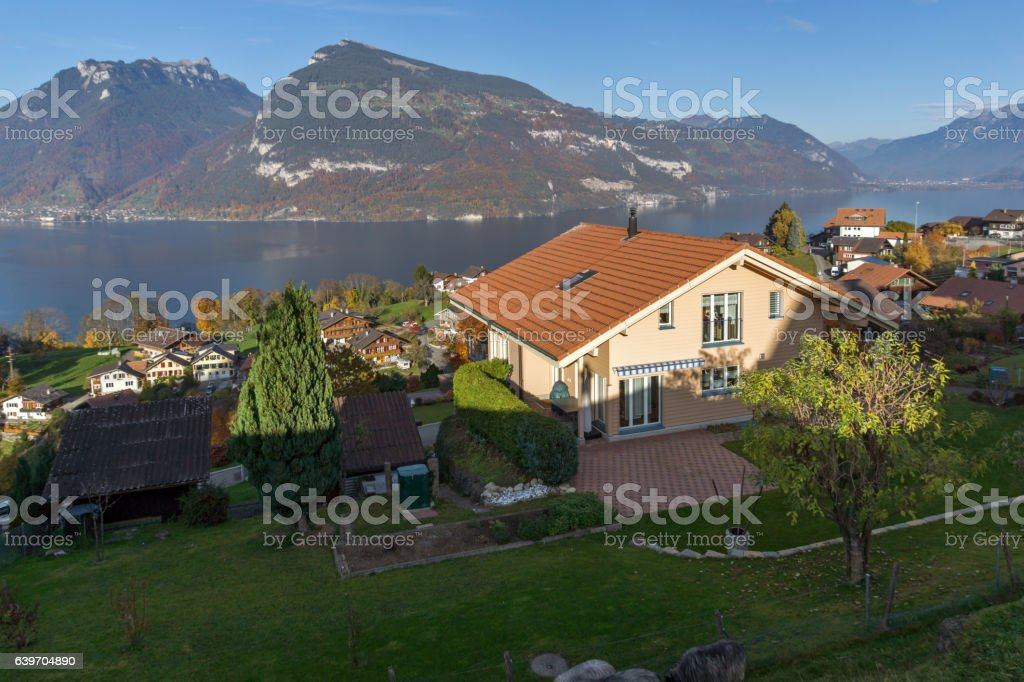 Amazing view of Lake Thun and typical Switzerland village stock photo