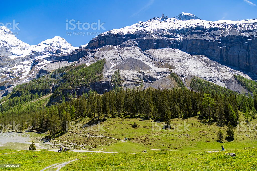 Amazing view of Swiss Alps and meadows near Oeschinensee, Switzerland stock photo