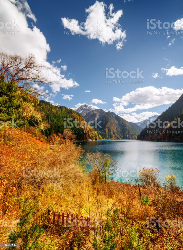 Amazing view of the Long Lake among fall woods and mountains stock photo