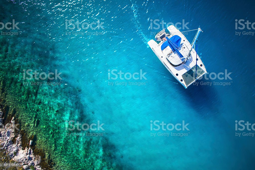 Amazing view to Catamaran in open sea at windy day stock photo