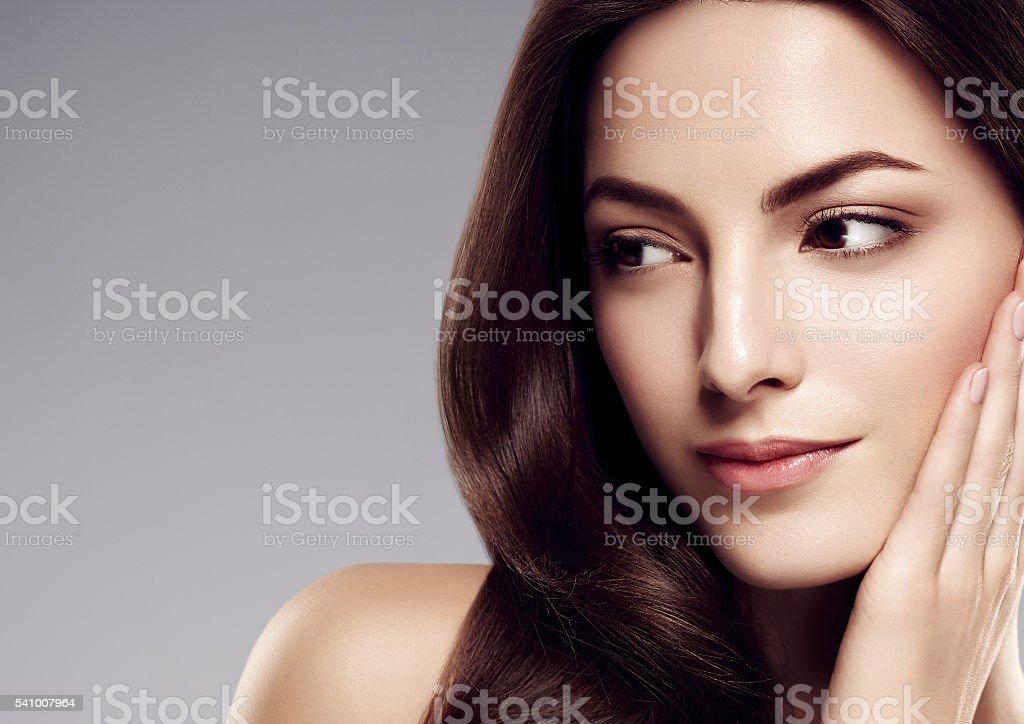 Amazing woman portrait. Beautiful girl with long wavy hair. stock photo