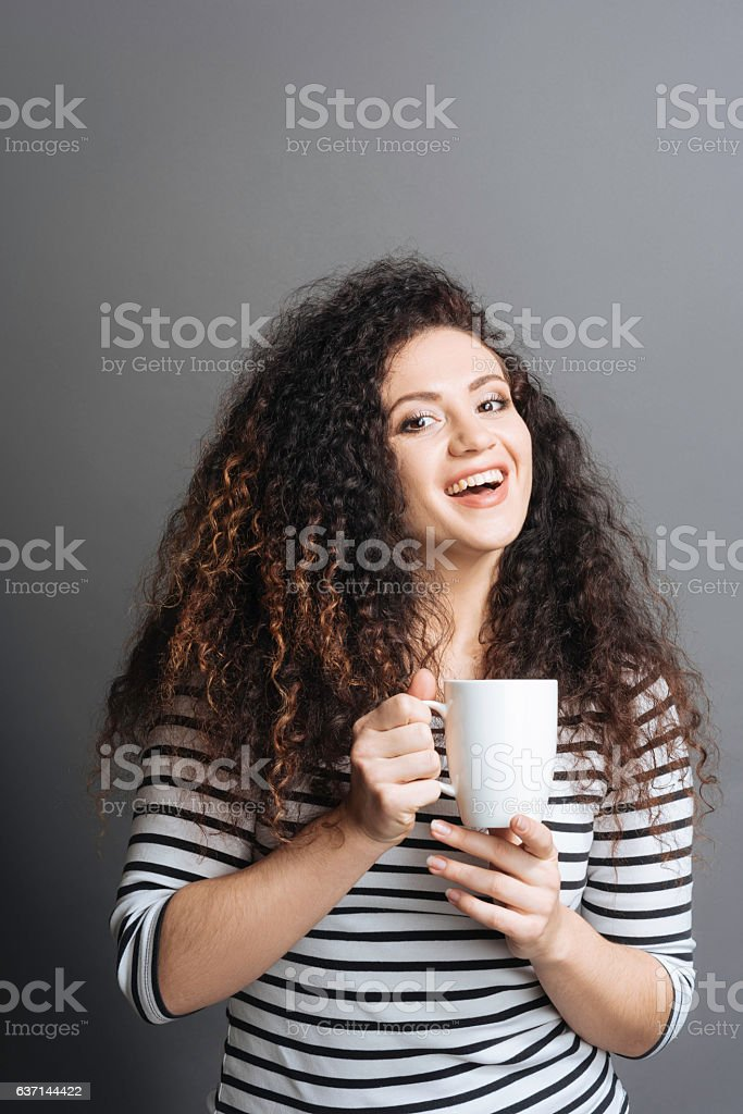 Amazing woman proposing having coffee-time stock photo