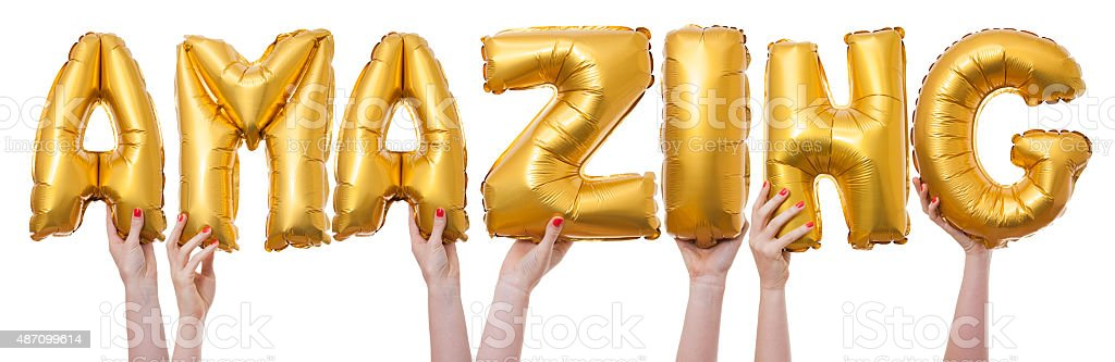 Amazing word made from gold balloons stock photo