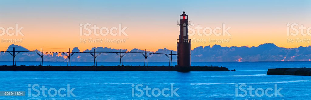 Amazingly beautiful predawn harbor and lighthouse stock photo