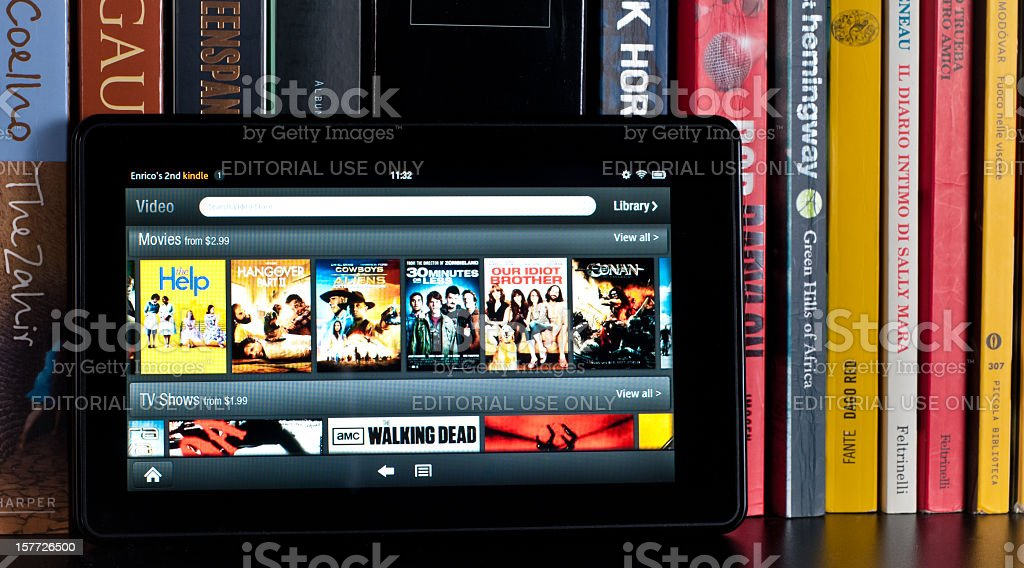 Amazon Kindle Fire tablet on a book shelf stock photo