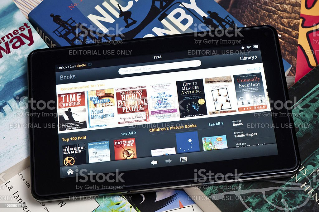 Amazon Kindle Fire tablet on a heap of books stock photo