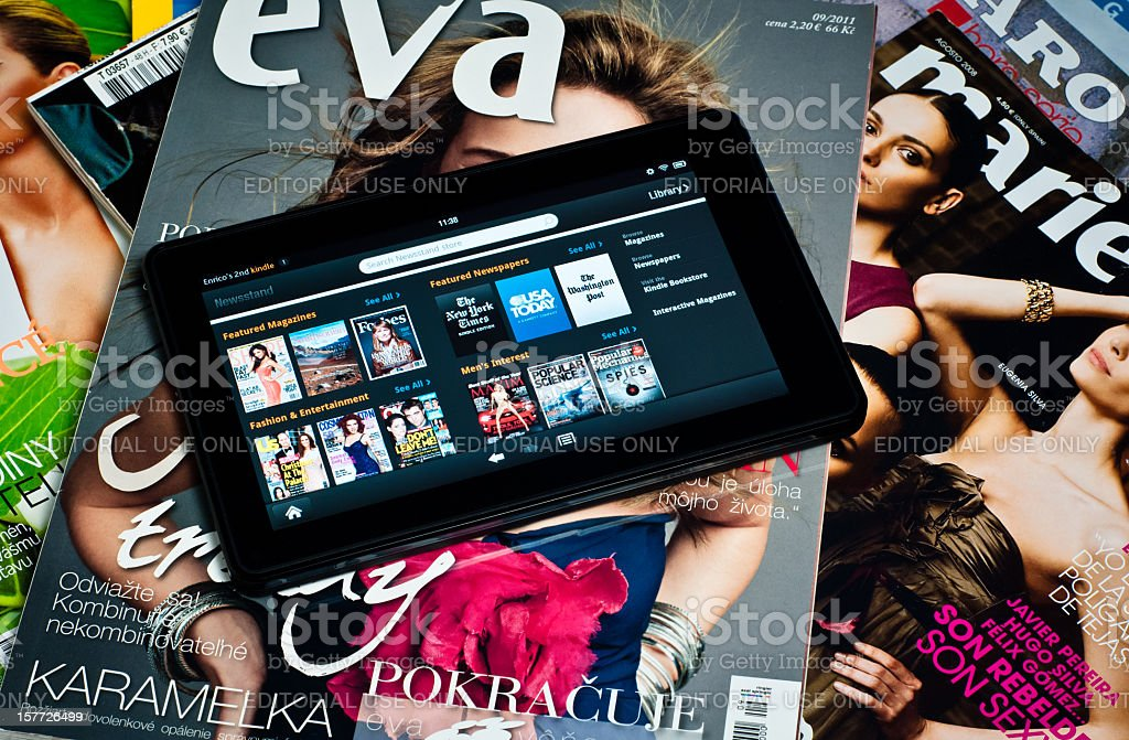 Amazon Kindle Fire tablet on paper magazines royalty-free stock photo