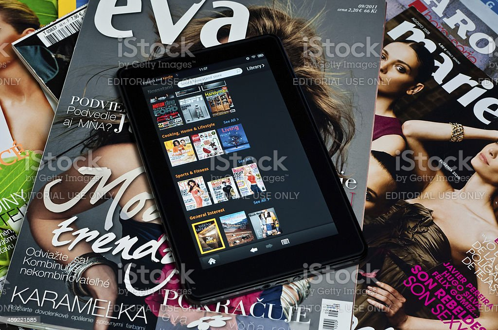 Amazon Kindle Fire tablet on paper magazines stock photo