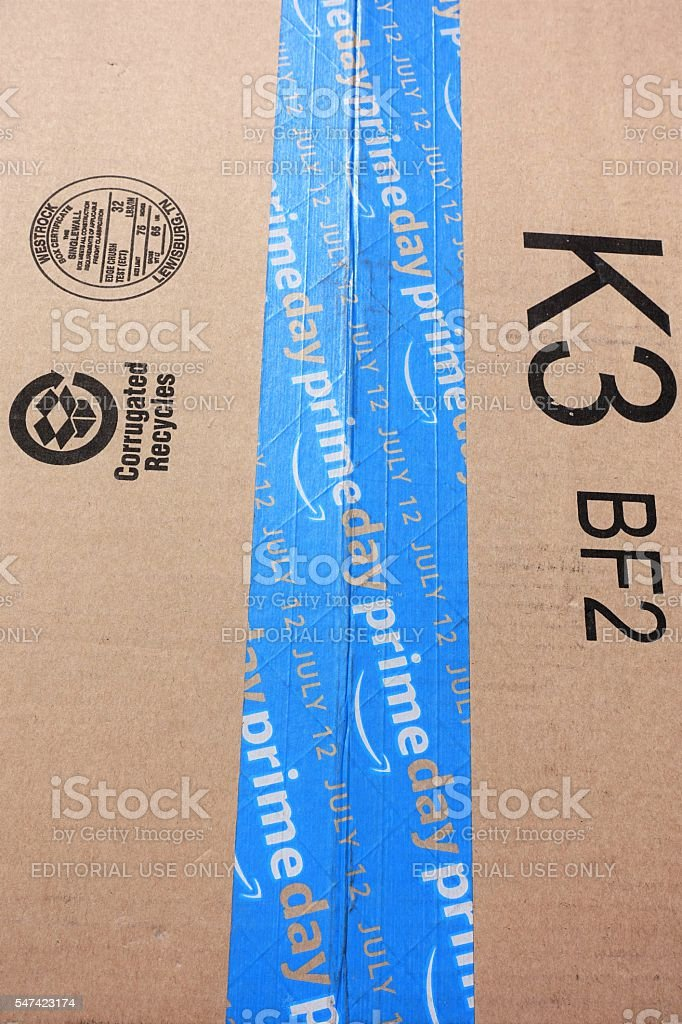 Amazon Prime Day shipping package with blue PRIMEDAY tape stock photo