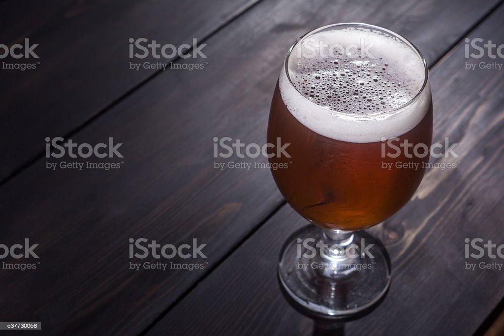 Amber ale on dark wood stock photo