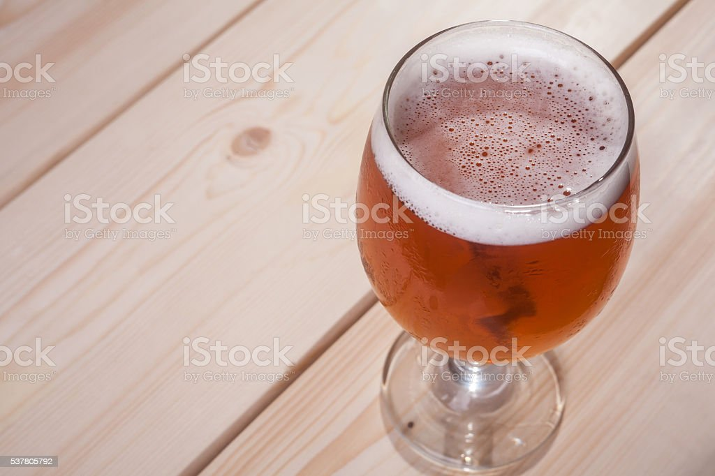 Amber ale on wood stock photo