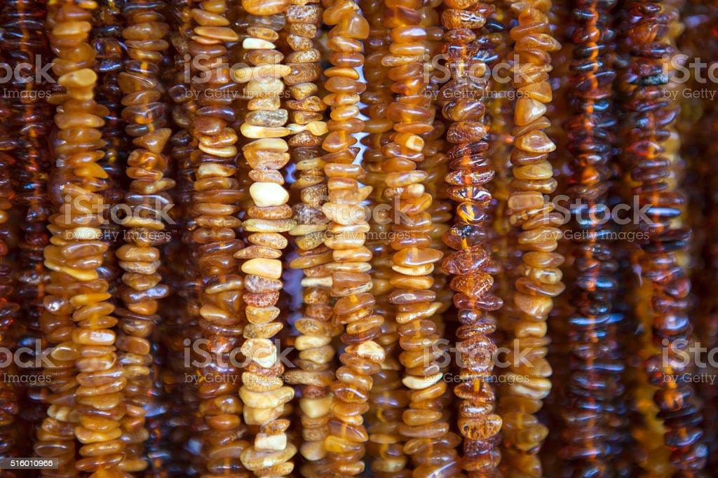 amber bracelets on market stock photo