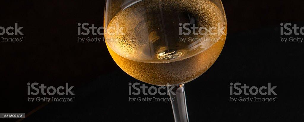 Amber dessert wine - glowy background stock photo